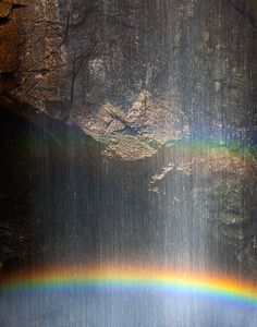 ✯ A rainbow forming in the spray at the base of a waterfall on a sunny day .. by Ian Plant✯