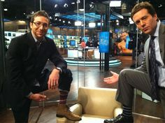 Jeff Glor and Josh Dean show off their dynamic socks