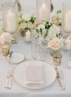 blush and ivory tabletop decor with candlelight | Photography: Greg Finck