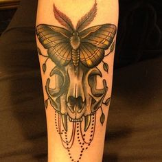 fuckyeahtattoos:  Cat Skull and Moth. Tattooed By Noelle LaMonica at the Velvet Grip in West Hollywood, CA.