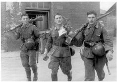 3 soldiers just after a battle, WW2, 1941, location unknown.