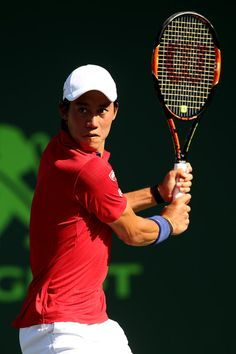 Kei Nishikori Photos - Miami Open - Day 11 - Zimbio