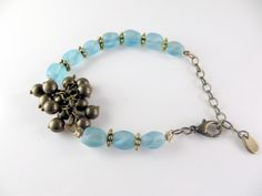 Light blue beaded cha cha bracelet with gold accents