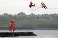 Breitling wingwalkers breathtaking display during the Littlehaven promenade opening day celebrations at South Shields.