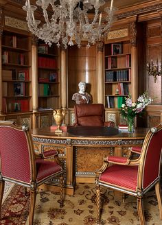 Home office / library - old world style, love the tile insets into the wood moldings!