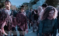 Rick and Carl (Chandler Riggs) attempt to evade the herd in a midseason premiere that sets a new record for most amount of zombies (1,300). #TheWalkingDead