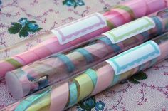 Ribbons attached to a wooden dowel ... inside a clear candy tube ... a special treat for ... children dancing at a wedding.