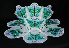 Lace Bowl & Doily - Chinese Butterflies Butterflies to mix and match! You receive 3 different bowl sides and doily petals so you can make a bowl of all one butterfly as illustrated or combine them in different ways. These butterflies can be stitched in unlimited color combinations and would look great done partially in metallic threads. For example, substituting the black thread with gold metallic would give them a whole new look.