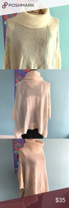 Gorgeous 360 Cashmere cowlneck tunic. Size L Softest cashmere in cream with light blue stripes and handkerchief hem, three-quarter length sleeves, fold over double-layer turtle/cowl neck Length is 24 inches at shortest point and 27 inches at longest. Very loose tunic fit with 29 inches across bust.  Excellent condition. 360 Cashmere Sweaters Cowl & Turtlenecks