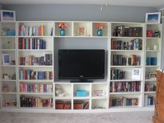 We finally finished our built-in bookcases in our master bedroom!! Billy bookshelves in 2 different sizes, plus Billy wallshelves, all from IKEA. I adore our room now!!