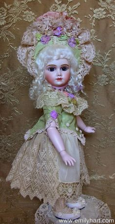 Steiner A19 French Antique Reproduction porcelain doll by Emily Hart. $1,999.99, via Etsy.