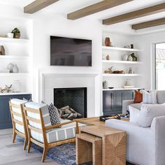 This living room is what dreams are made of! At least my dreams...anyone else? The exposed beams, the blue hues, the textured marble fireplace and some of my favorite furnishings! #LindyeGallowayInteriors