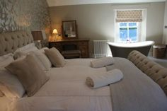 Stair Cottage, Master Bedroom with freestanding bath, Lakes Cottage Holidays