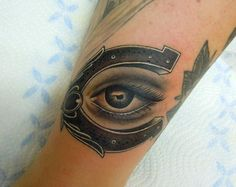 Shoe Horse and Eye Good luck Charm Arm Tattoo By Phatt German