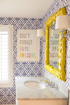 Blue white wallpaper | yellow framed mirror | marble counter top | Don't forget to be awesome sign | bathroom