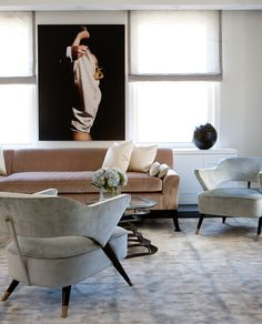 Weitzman Halpern Interior Design | natural tones + comfy living room with modern wall photograph art