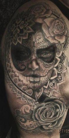 Ghostly looking sugar skull tattoo