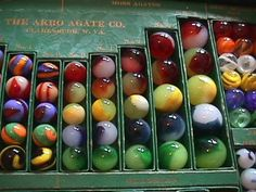 Moss agate marbles by Akro Agate Marble Co., salesman's sample box.