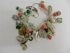 Religious charm bracelet with Catholic holy medals of Saints and the Virgin Mary with handmade beaded charms made of crystals and lamp work beads.  The silver plated chain link bracelet has holy medals from Italy and pewter charms. They are as follows:  Divine Mercy Our Lady of San Juan St Christopher Virgin of Seven Sorrows St Michael /Guardian angel St Jude Thaddeus Our Miraculous Lady Holy Family Madonna  Some of these charms have Pray for us on the back.  There is a winged heart pewt...