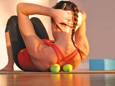 If you have tightness in your back, rolling on top of a tennis ball may help stretch out that particular painful spot.