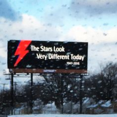 An anonymous fan pays tribute to the late David Bowie with a billboard outside Detroit...
