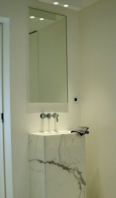 Nice Carrara marble sink for a small bathroom. -  To connect with us, and our community of people from Australia and around the world, learning how to live large in small places, visit us at www.Facebook.com/TinyHousesAustralia