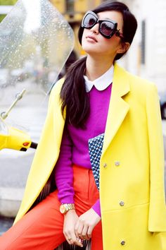 Bold coloured fashion editorial - magenta pink peter pan collared top, orange / red trousers and bright yellow summer coat - http://pinterest.com/arenaint