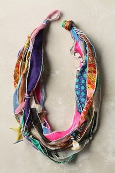 "DIY scarf necklace  We Love Vera took some of their namesake's printed scarves, cut them into strips and wrapped and knotted them into a colorful, scarf-necklace hybrid. Silk 26""L, 2""W"