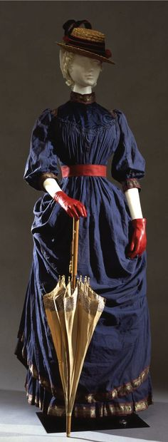 Walking dress by Atelier Callot Soeurs, Paris, c. 1884, at the Pitti Palace Costume Gallery. Polonaise dress in cobalt-blue cotton muslin. Via Europeana Fashion.