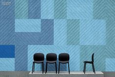 34 Functional Building Products | Acoustic panels by Form Us with Love for Baux. In an earth-toned palette inspired by Scandinavian forests, geometric panels composed of spruce shavings and cement bring the quiet of nature indoors.
