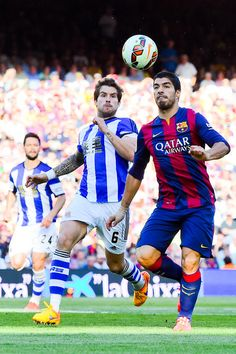 Luis Suarez of FC Barcelona competes for the ball with Inigo Martinez of Real Sociedad de Futbol during the La Liga match between FC Barcelona and Real Sociedad de Futbol at Camp Nou on May 9 2015 in Barcelona Catalonia. Fc Barcelona, Barcelona Catalonia, Marc Andre, Soccer News, Camp Nou, Soccer Cleats, Brazil, Football, Sports