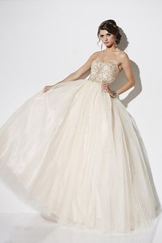 Balletts Bridal - 22670 - Prom by Jacquelin Bridals Canada - This ball gown is beautifully beaded; it has a sweetheart strapless bodice with a natural waist, and a very full tulle ball gown skirt.