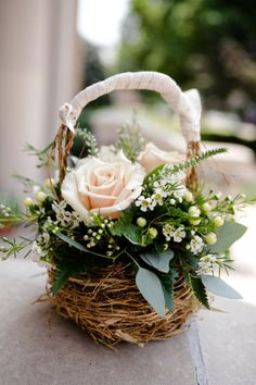 natural and pretty flower arrangement in a rustic basket flower girl  basket flowers