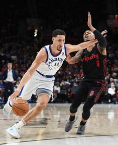 meet a1123 c4416 Golden State Warriors guard Klay Thompson drives to the basket against Portland  Trail Blazers guard Damian Lillard during the second half of an NBA ...