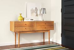 Mid-century details like solid wood turned and tapered legs and beveled edges lend an air of refinment to the Grove console table. Handcrafted by Pennsylvania woodworkers, Grove features an oil-and-wax finish that enhances the natural grain pattern of its solid wood construction.