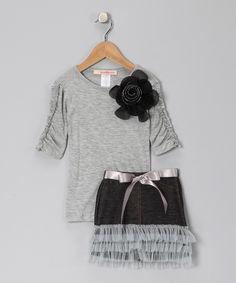 short black skirt (minus ruffles and ribbbon)...grey shirt (loose fitting) Black Flower Short-Sleeve Tee & Skirt - Toddler & Girls