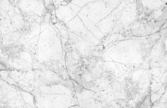 This textured white marble wallpaper is a sleek and stylish choice that would look great as kitchen or living room wallpaper when creating a modern space.