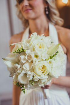 Classic white bouquet | Photography: IQphoto - iqphoto.com  Read More: http://www.stylemepretty.com/little-black-book-blog/2014/04/29/intimate-elopement-at-san-francisco-city-hall/