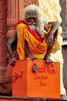 Sadhu guarding the donation box, Rajasthan, India Religions Du Monde, Cultures Du Monde, World Cultures, We Are The World, People Around The World, Nova Deli, Namaste, Amazing India, Indian People