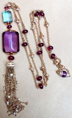 This Bulgari amethyst and aquamarine pendant necklace has cabochon spinels up the chain. The perfect way to wear these coloured gemstones. Discover the collection by Bvlgari inspired by the colourful surrounds of Italy: http://www.thejewelleryeditor.com/jewellery/magnificent-inspirations-bulgari-jewellery-collection-serpenti-italian/ #jewelry