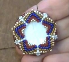 How to bezel a mother of pearl disc with beads (Bead pattern - Peyote Stitch) | Beading Tutorial