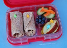 Easy bento lunch ideas for kids - simple and healthy air transport bento lunch in the Yumbox UK panino bento box - with bento picks to decorate - Eats Amazing UK
