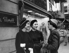 """Junior editors at Mademoiselle magazine, a marriage of lip gloss and literature, the """"quality magazine for smart young women"""". Manhattan :1949 outside of the Walter Florell millinery salon."""
