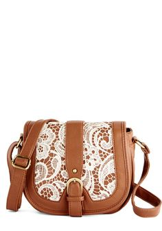 Hello, Good Buyer Bag. This lacy crossbody bag turns your style sourcing trip into a feel-good adventure! #tan #modcloth