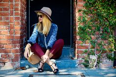 hat, colored pants and patterned shirt