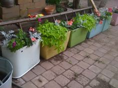 Recycling Vintage Toilet Tanks into Planters! What Fun!