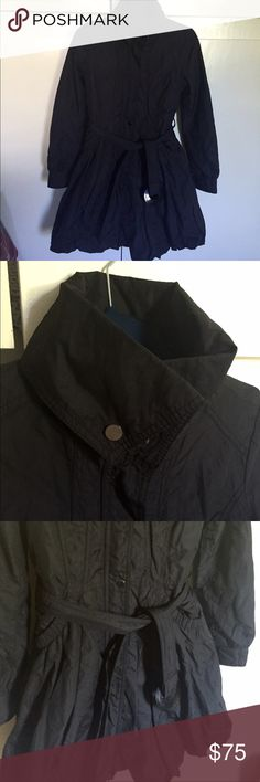 LAUNDRY SHELLI SEGAL Funnel Neck coat Black funnel neck coat size extra small. This coat is from the brand laundry by Shelli Segal. It's sort of a trench coat, but has a little more padding/warmth. It is a nylon material on the outside, so it is slightly water resistant. this is in great condition, but I would recommend getting it clean because it's been kept in storage for the last couple of years. Laundry by Shelli Segal Jackets & Coats Trench Coats