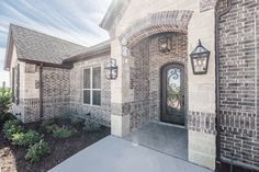 Brick color is Sheltered Bluff by Boral with buff mortar. Stone is Gray Leuders with buff mortar. Roof is Tamko Rustic Black. Exterior trim and garage door color is Sable Exterior stain is New Ebony.