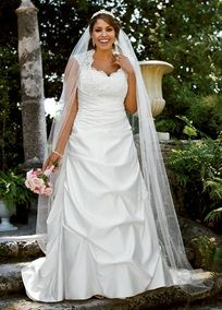 Romantic and luxurious, this satin cap sleeved A-line gown will take people's breath away as you walk down the aisle.   Sweetheart bodice is covered in beaded lace for a look that is sought-after and supportive.  Illusion cap sleeves and back are unique and add a touch of romance.  Side-draped satin and pick-up detail on the skirt is flattering on all figures.  Chapel train.  Fully lined. Imported polyester. Dry clean only.  Available in Ivory in stores or online. White only available in…
