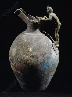 Bronze pitcher with anthropomorphic handle, from Pompeii, Campania, Italy. Roman civilisation, 1st century BC. Naples, Museo Archeologico Nazionale
